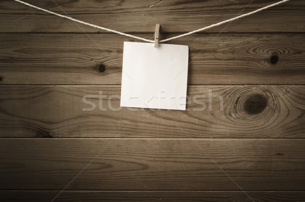 Blank Message Pegged to String against Wood Planks Stock photo © frannyanne