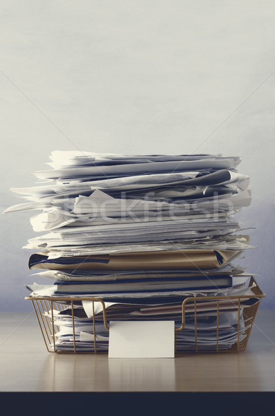 Wire Office Tray Piled Up with Papers Stock photo © frannyanne