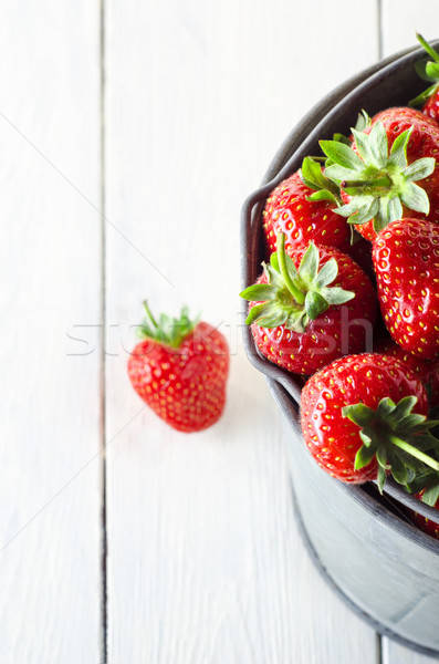 Bucket of Strawberries from Above on White Planked Table Stock photo © frannyanne