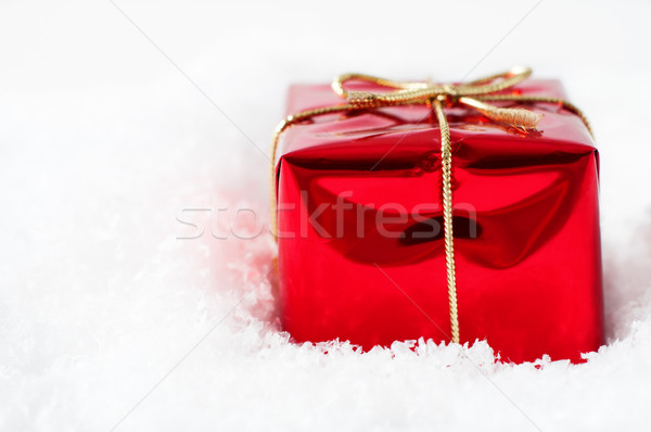 Christmas Gift Box in Snow Stock photo © frannyanne