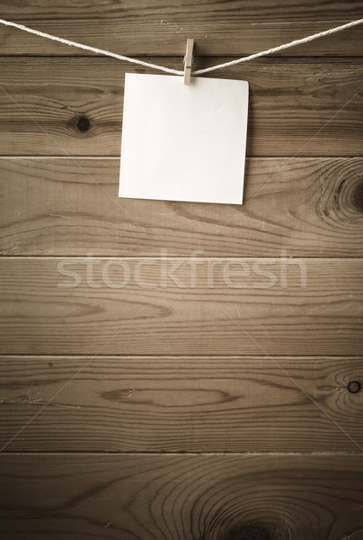 Blank Reminder Note Pegged on Clothesline against Wood Planking Stock photo © frannyanne