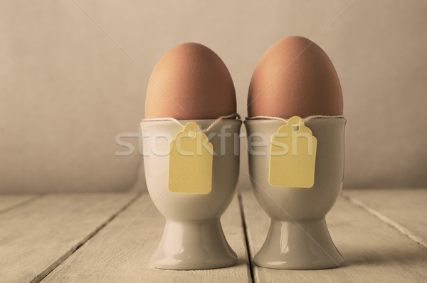 Two Eggs in Eggcups with Labels on String  Retro Stock photo © frannyanne
