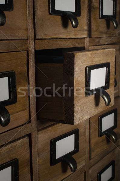 Kártya fiók kinyitott sötét szoba oldalnézet Stock fotó © frannyanne