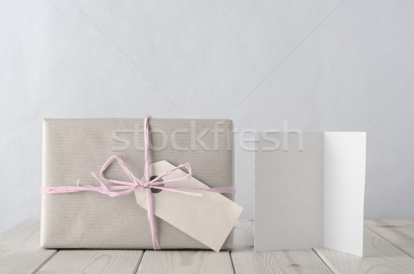 Simply Wrapped Gift Box with Icy Pink Raffia and Greeting Card Stock photo © frannyanne