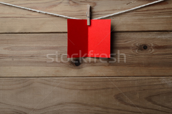 Red Greetings Card Pegged to String on Wood Plank Background Stock photo © frannyanne
