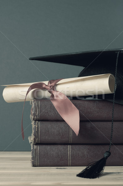 Graduation Mortarboard, Degree Scroll and Books - Faded Tones Stock photo © frannyanne
