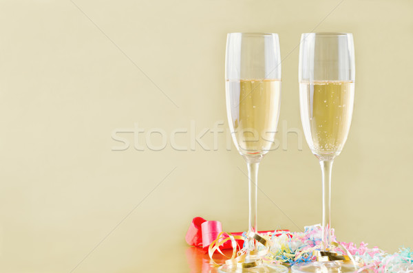 Champagne and Streamers on Gold Stock photo © frannyanne