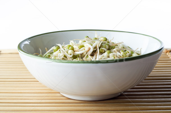 Bowl of Beansprouts on Bamboo Placemat Stock photo © frannyanne