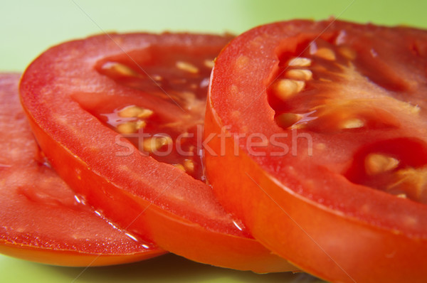 Tomato Slices on Green Stock photo © frannyanne