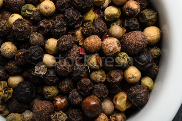 Mixed Peppercorns Macro in White Bowl from Above Stock photo © frannyanne