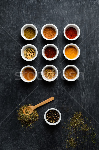 Overhead of Spice Bowls On Black Chalkboard with Scattered Herbs Stock photo © frannyanne