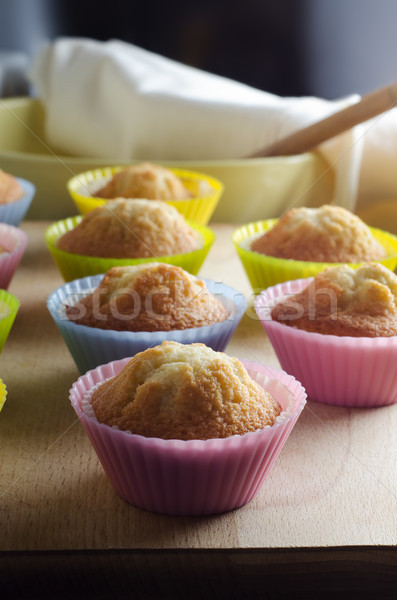 Freshly Baked Cupcakes on Wooden Board in Sunlit Kitchen Stock photo © frannyanne