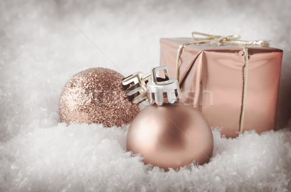 Pale Pink Christmas Decorations in Snow Stock photo © frannyanne