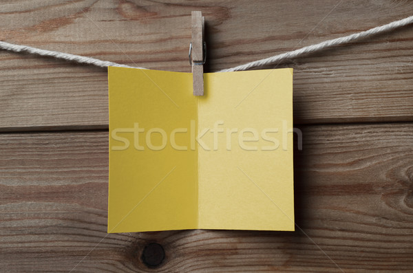 Blank Yellow Greetings Card Pegged to String on Wood Stock photo © frannyanne
