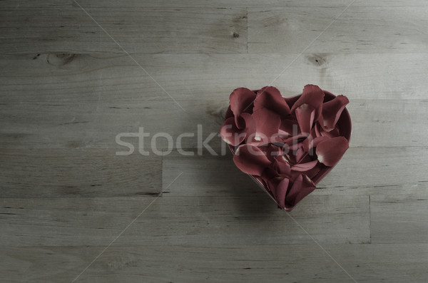 Overhead of Rose Petals Filling Heart Shaped Bowl Stock photo © frannyanne