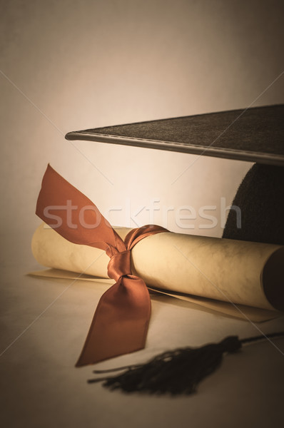 Mortarboard and Diploma Scroll Tied with Ribbon with Vintage Eff Stock photo © frannyanne