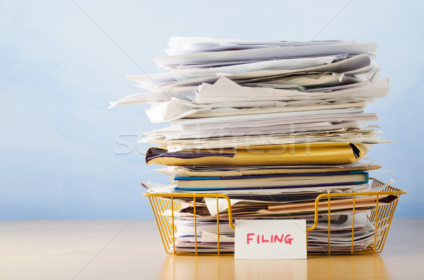 Filing Tray Piled High with Documents Stock photo © frannyanne