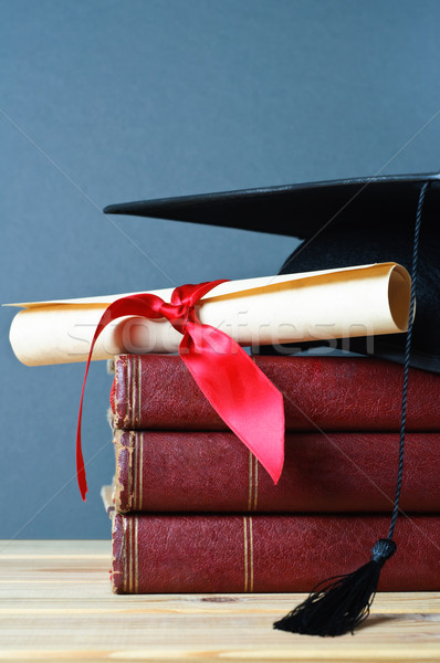 Graduation Mortarboard, Scroll and Books Stock photo © frannyanne