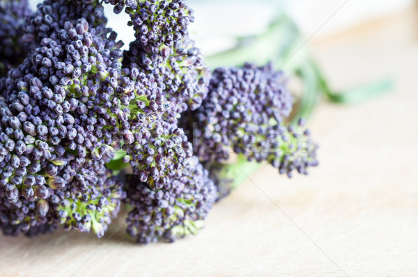 Purple Sprouting Broccoli on Wooden Table Closeup Stock photo © frannyanne