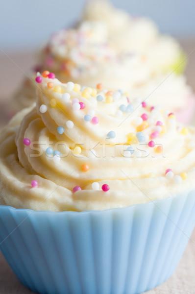 Díszített csésze torták közelkép csetepaté örvények Stock fotó © frannyanne