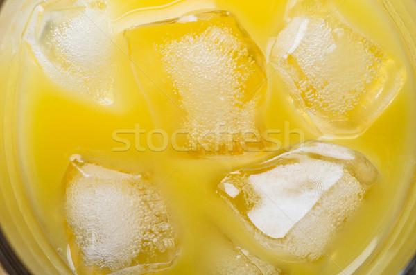 Orange Juice and Ice Cubes Overhead Stock photo © frannyanne