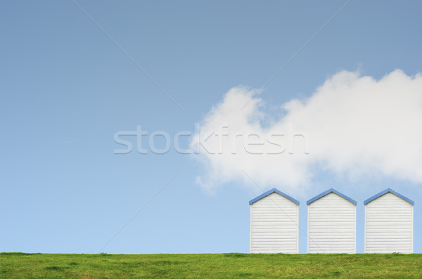 Trois plage ciel bleu rangée herbeux colline Photo stock © frannyanne