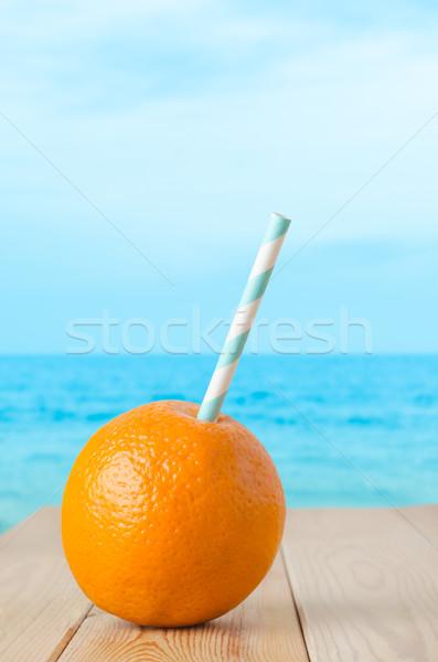 Fresh Orange Drink by Seaside Stock photo © frannyanne