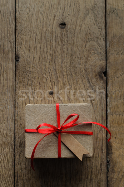Plain Brown Gift Box with Red Ribbon and Vintage Style Blank Tag Stock photo © frannyanne