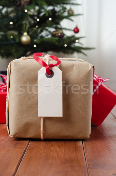 Parcel and Gifts on Wood with Christmas Tree Stock photo © frannyanne