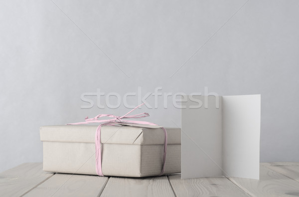 Simply Wrapped Gift Box with Icy Pink Raffia bow tie and Greetin Stock photo © frannyanne