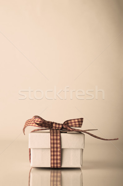 Retro White Christmas Gift Box Tied with Gingham Ribbon Stock photo © frannyanne