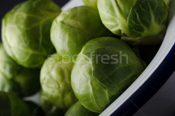 Enamel Baking Tin filled with Leafy Green Brussel Sprouts Stock photo © frannyanne