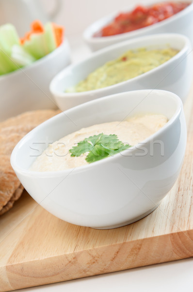 Hummus, Guacamole and Salsa Dip Bowls Stock photo © frannyanne