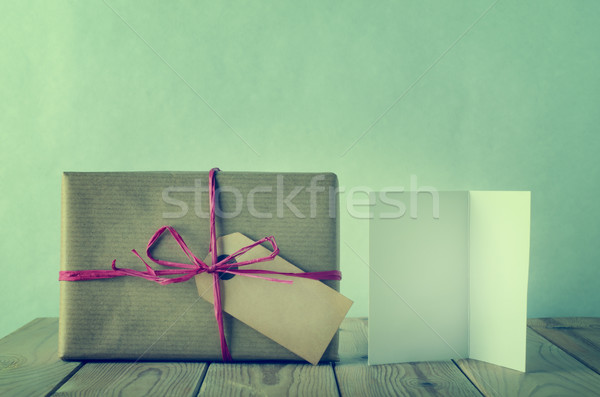 Wrapped and Labeled  Brown Paper Gift with Raffia Bow and Blank  Stock photo © frannyanne