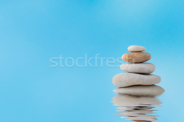 Stacked Stones with Watery Reflection against Blue Sky Stock photo © frannyanne