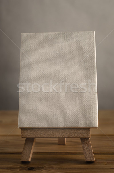 Art Canvas Easel in Portrait Orientation on Wood Plank Floor Stock photo © frannyanne