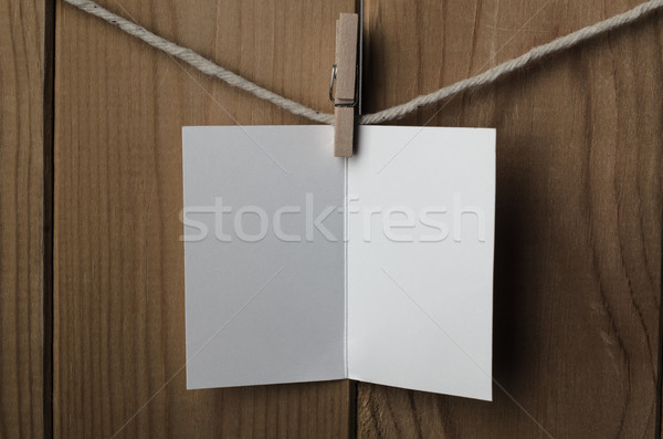 Blank White Opened Greetings Card Pegged to String Stock photo © frannyanne