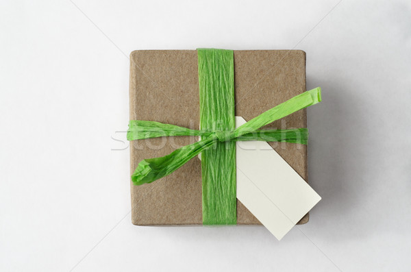 Overhead of Simple Brown Gift Box with Green Raffia Ribbon and B Stock photo © frannyanne