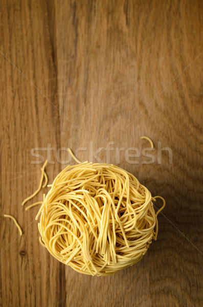 Stock photo: Egg Noodles Nest Stack From Above on Wood