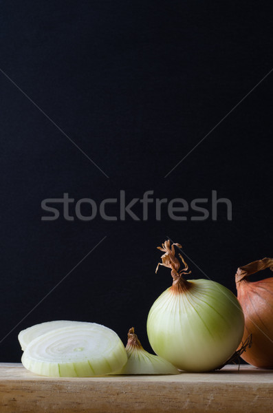 Onions Arranged on Chopping Board Stock photo © frannyanne
