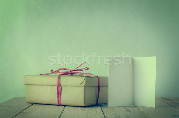 Simple Raffia Tied Gift Box with Blank Open Card Stock photo © frannyanne
