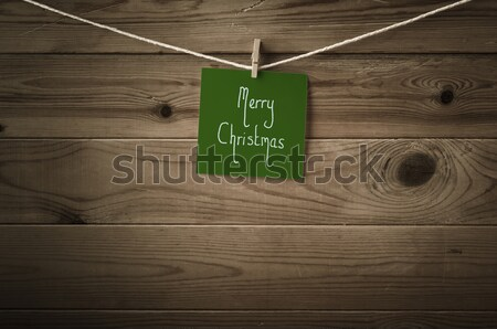 Light Green Greetings Card Pegged to String on Wood Background Stock photo © frannyanne