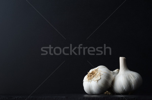 Garlic Bulbs Grouped on Black Stock photo © frannyanne