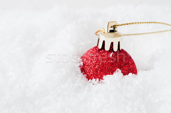 Red Christmas Bauble in Snow Stock photo © frannyanne