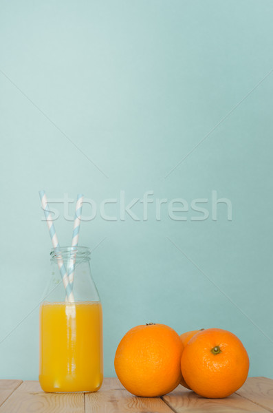 Fresh Orange Juice in Retro Bottle with Straws and Grouped Orang Stock photo © frannyanne