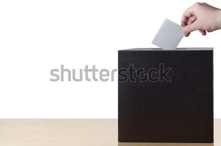Hand Placing Voting Slip in Ballot Box Stock photo © frannyanne