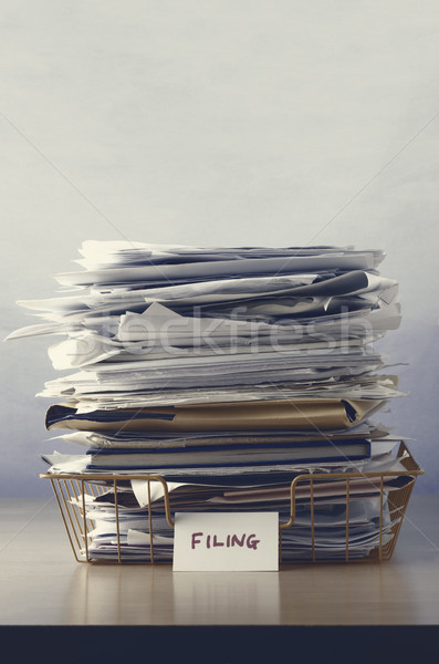 Filing Tray Piled Up with Papers Stock photo © frannyanne