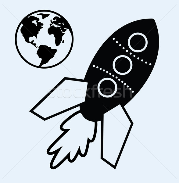 rocket ship and planet earth symbols Stock photo © freesoulproduction