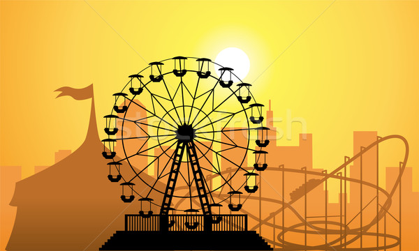 Stock photo: vector silhouettes of a city and amusement park