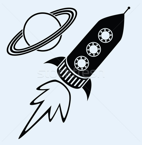 rocket ship and planet saturn symbols Stock photo © freesoulproduction